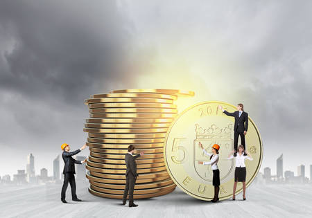 Business people and macro stack of euro coins photo