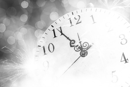 twelve month old: Conceptual image of clock with bokeh lights and firework Stock Photo