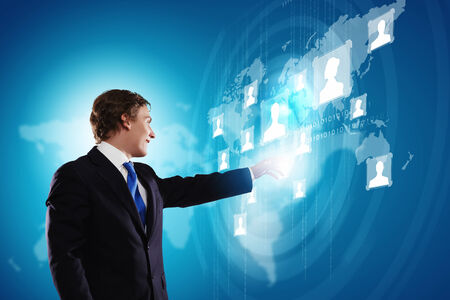 Businessman in suit against digital background with icons photo