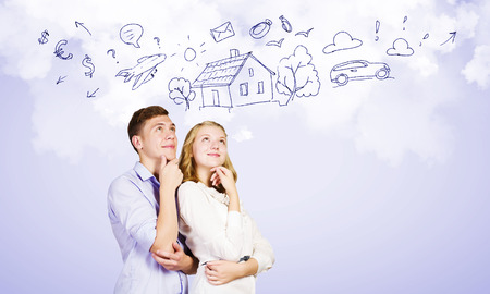 Conceptual image of young couple hugging each other and dreaming