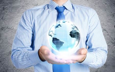 Close up of businessman holding Earth planet in palms photo