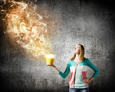 fume: Young girl holding bucket with flying out fume