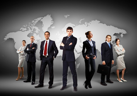 Image of businesspeople standing against world map background Stock Photo - 29570027