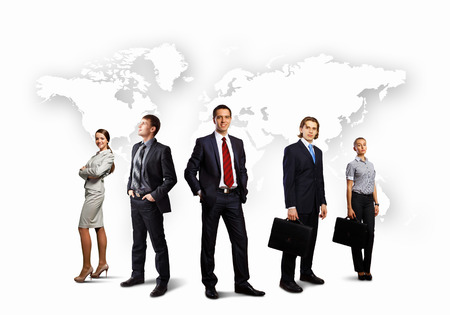 Image of businesspeople standing against world map background Stock Photo - 29570073
