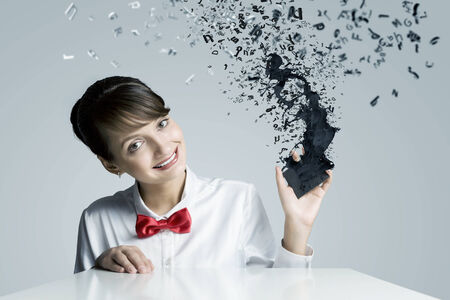 Young woman holding mobile phone with icons photo