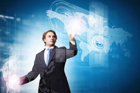 Businessman in suit touching icon of media screen photo