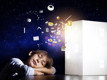 Cute little boy sleeping and dreaming about home photo