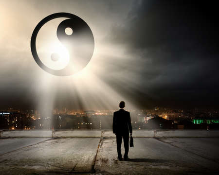 yinyang: Rear view of businessman looking at yin yang sign