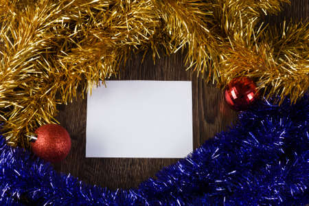 White blank card with decoration balls and tinsel  Place for text photo