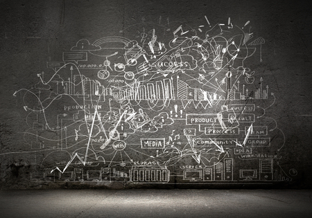 Business sketches and drawings on black wall photo