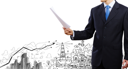 businessman standing: Close up of businessman with papers in hands