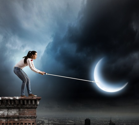 Young woman in casual holding moon on lace photo