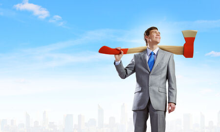 malefactor: Young determined businessman with axe on shoulder