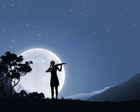 Silhouette of woman playing violin at night Stock Photo