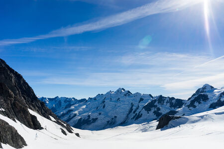 ski area: Mountain landscape with snow and clear blue sky