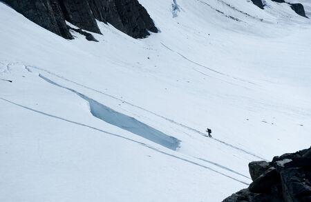 snows: Man walking among snows of New Zealand mountains Stock Photo