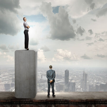 Conceptual image of businessman and businesswoman standing on top of bar photo