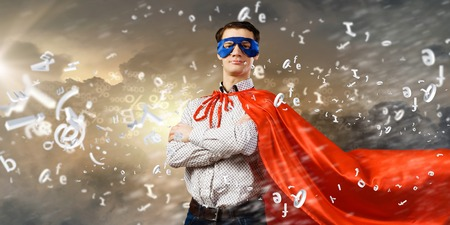 Young man wearing superhero mask and cape photo