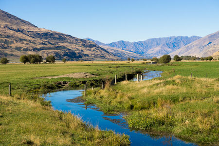 Natural landscape of New Zealand alps and stream photo
