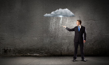 sobbing: Young businessman under raining sky  Failure concept