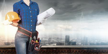 waist belt: Bottom view of woman engineer with tool belt on waist Stock Photo