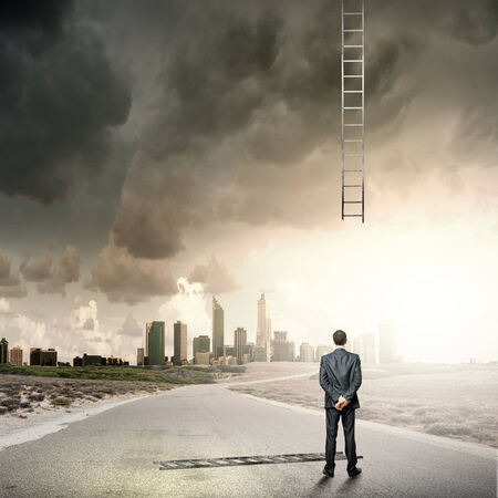 goal oriented: Rear view of businessman looking at broken ladder Stock Photo