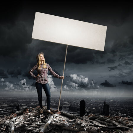 Young woman in casual carrying white blank banner photo