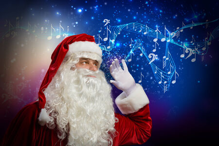 Santa Claus enjoying sound of distant music photo
