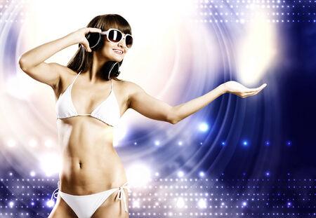 Young attractive girl in white bikini and headphones photo