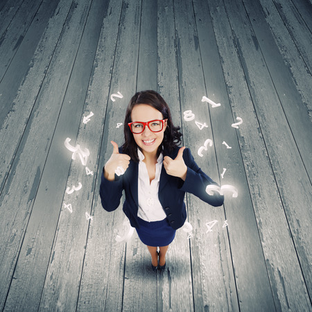 Top view of young pretty businesswoman with thumbs up photo