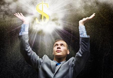 Businessman looking at shining dollar symbol above photo