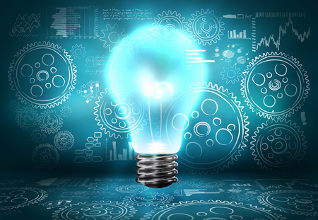 Conceptual image with light bulb and cogwheels on blue backdrop photo