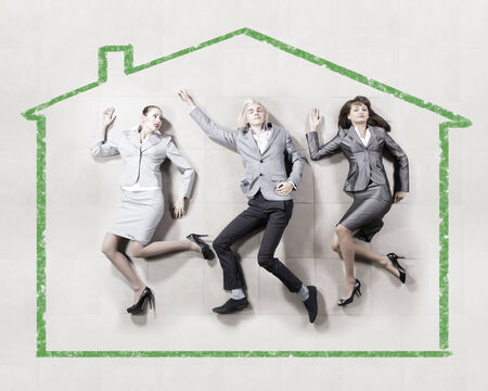 Funny businesspeople lying on floor and acting like running photo