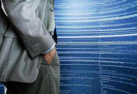 metadata: Bottom view of businessman and digital background