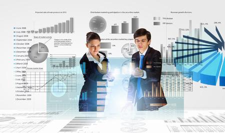 analyzing: Businessman and businesswoman analyzing data information of market