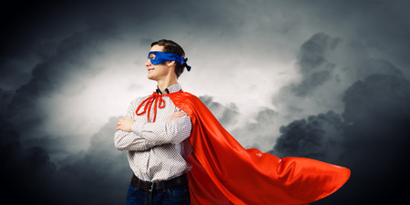 Young man wearing superman mask and cape photo