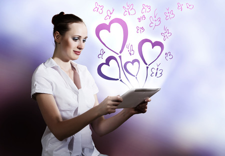 Young woman using holding tablet pc  Romance concept photo