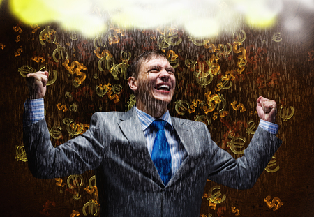 exult: Cheerful businessman with hands up celebrating success