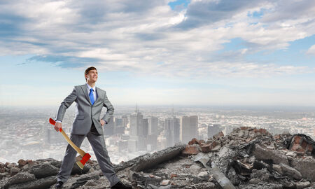 psychopath: Young determined businessman with axe in hands