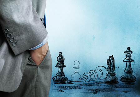 Bottom view of businessman and chess game at background Stock Photo