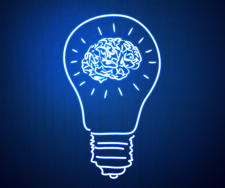 Conceptual image of light bulb and human brain photo