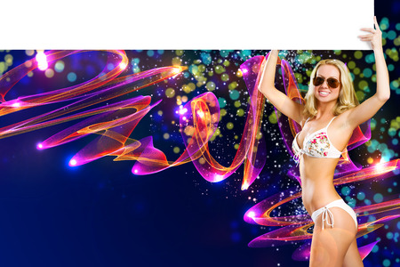 Young attractive blond in bikini holding blank banner photo