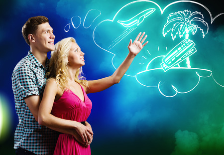 Young happy couple dreaming about future vacation photo