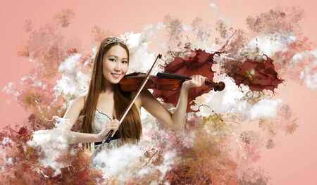 Young pretty asian woman playing violin  Young talent Stock Photo - 30537089
