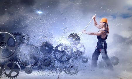 Strong man mechanic in uniform with spanner fixing mechanism Stock Photo - 30537093