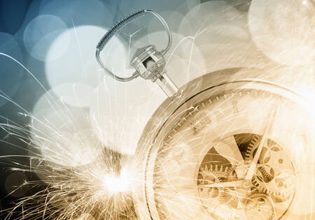 Conceptual image with pocket watch bokeh lights and fireworks photo