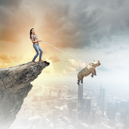 lead rope: Young woman in casual and rhino flying in sky