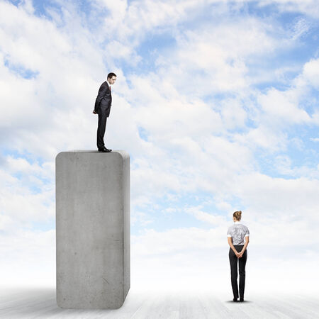 Conceptual image of businessman standing on bar and looking down at woman photo