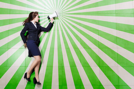 Funny businesswoman lying on floor businesswoman holding megaphone photo