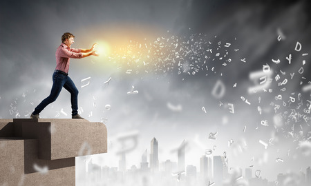 supernatural power: Young man in casual throwing light splashes